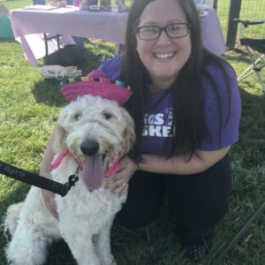 Megan our sitter with a sweet golden doodle at Woofstock
