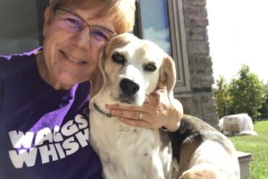 Our Owner Kelly Catlett with Momma the beagle